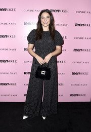Sophia Bush accessorized her outfit with a crystal-buckle velvet purse.
