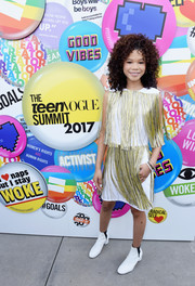 Storm Reid rounded out her look with white ankle boots by Rebecca Minkoff.