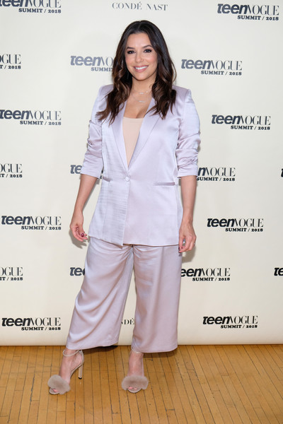 Eva Longoria added a touch of boudoir glamour with a pair of nude fur sandals by Max Mara.