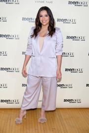 Eva Longoria donned a lilac wide-leg pantsuit by Styland for the Teen Vogue Summit.
