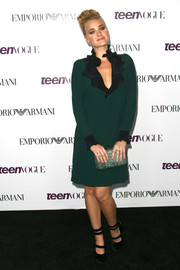 Amanda Michalka opted for a modest yet stylish green dress featuring a black ruffle collar and cuffs when she attended the Teen Vogue Young Hollywood party.