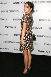 Zoey Deutch donned stylish black ankle-strap pumps with a floral dress for the Teen Vogue Young Hollywood party.