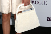 Bailee Madison accessorized with a very ladylike beaded white purse when she attended the Teen Vogue Young Hollywood party.