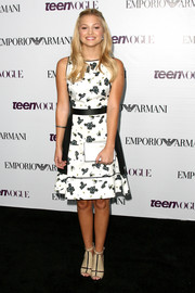Olivia Holt oozed a youthful, stylish vibe in a black-and-white print dress during the Teen Vogue Young Hollywood party.