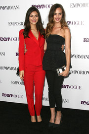 Madison Guest looked sexy and elegant in a strapless black peplum top and cigarette pants at the Teen Vogue Young Hollywood party.