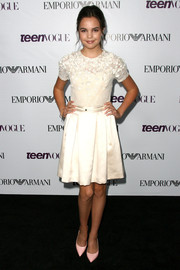 Bailee Madison exuded a ladylike vibe at the Teen Vogue Young Hollywood party in a white cocktail dress with a flower-appliqued neckline.