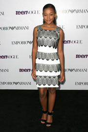 Amandla Stenberg exuded a 1920s vibe in a black-and-white sheath dress with scalloped detailing at the Teen Vogue Young Hollywood party.
