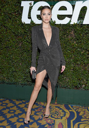 Delilah Belle Hamlin oozed sex appeal in a beaded charcoal-gray dress with a plunging neckline and an asymmetrical hem at the Teen Vogue Young Hollywood party.