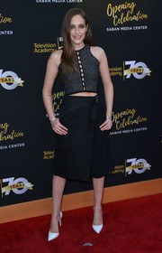 Carly Chaikin teamed her top with a black A-line wraparound skirt.