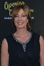 Allison Janney styled her hair into a messy-glam updo with parted bangs for the Television Academy's 70th anniversary gala.