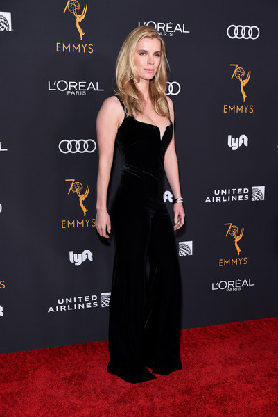 Betty Gilpin sheathed her figure in a black velvet jumpsuit for the Television Academy Emmy nominees party.