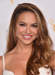 Chrishell Stause wore her long hair down in a wavy style at the Daytime Peer Group celebration.