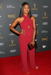 Angela Bassett teamed her outfit with a patterned box clutch.