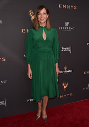 Allison Janney kept it demure and chic in a green keyhole-neckline cocktail dress at the Television Academy's performers peer group celebration.