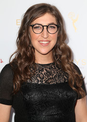 Mayim Bialik styled her hair with tight waves for the cocktail reception celebrating the 67th Emmys.