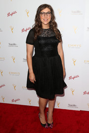 Mayim Bialik kept it classic in this lace-bodice LBD at the cocktail reception celebrating the 67th Emmys.