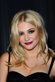 Pixie Lott added a splash of color with berry lipstick.