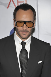 Tom Ford paired his classic suit with round sunglasses.