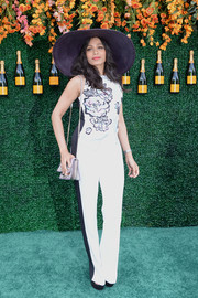 Freida Pinto opted for an Elie Saab jumpsuit with a floral-print bodice and black side stripes when she attended the Veuve Clicquot Polo Classic.