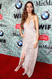 Angela Sarafyan was boho-sexy in a plunging, high-slit halter gown by Martha Medeiros at the Women in Film pre-Oscar cocktail party.