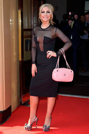 Heidi Range stepped on the red carpet wearing her colorful platform slingbacks.