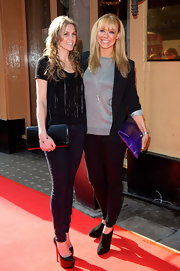 Liz Mcclarnon wore a black blazer over a sparkly silver sweater for a preppy-chic look.