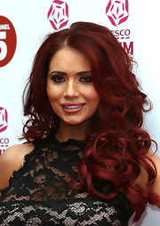 Amy Childs showed off her full lips with pink gloss.