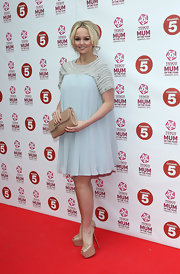 Jennifer Ellison opted for classic flowy dress with an embellished neckline for her red carpet look.