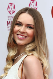 Zoe Salmon looked glamorous with old-school waves at the Tesco Mum of the Year Awards.