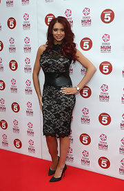 Amy Childs showed her sexy curves with this black lace cocktail dress with leather waist.