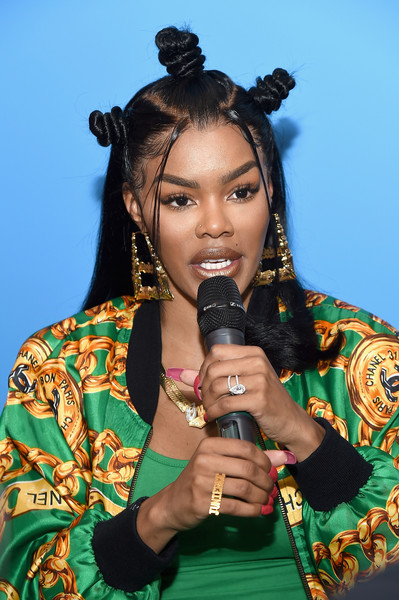 We're loving this half-up coiled hairstyle Teyana Taylor wore to the grand opening of her Junie Bee Nail Salon!