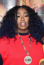 Missy Elliott worked a voluminous curly 'do at the grand opening of Junie Bee Nail Salon.