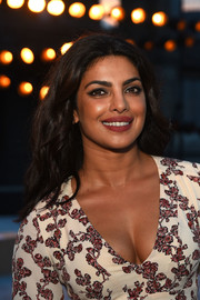 Priyanka Chopra sported loose center-parted waves at the Thakoon fashion show.
