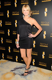 Nancy O'Dell showed off her sleek figure in a one-shouldered black dress. She complemented her look with a loose side bun.