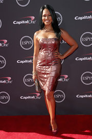 Garcelle Beauvais stunned in a rosy metallic dress that featured geometric leather panels.