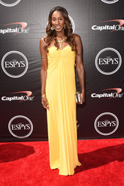 Lisa Leslie channeled her inner goddess in a draped yellow strapless gown styled with gold jewels during the ESPYs.