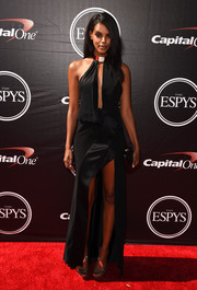 Grace Mahary flashed plenty of skin at the ESPYs in a high-slit black halter gown with a keyhole cutout.
