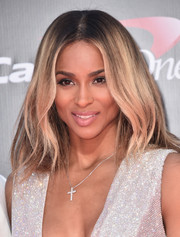 Ciara complemented her sparkly dress with a diamond cross pendant.