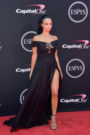Draya Michele was sexy-goth in an off-the-shoulder black Tadashi Shoji gown with a slashed bodice and a thigh-high slit at the 2017 ESPYs.