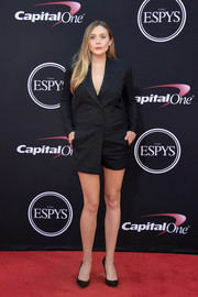 Elizabeth Olsen matched her suit with a pair of crystal-heel pumps by Sophia Webster.