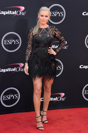 Lindsey Vonn sealed off her look with a pair of strappy, crystal-heel sandals by Sophia Webster.