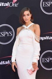 Olivia Culpo attended the 2017 ESPYs carrying a perspex clutch with a pink satin pouch inside.