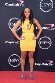Rachel Lindsay went for a loud color combo, pairing her yellow dress with purple T-strap sandals.