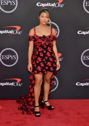 Chunky black platforms completed Chloe Kim's red carpet look.