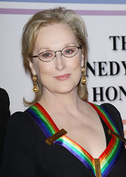 Meryl Streep attended the 34th Kennedy Center Honors wearing a pair of 19th century gold Etruscan revival pendant earrings.