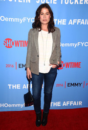 For her shoes, Maura Tierney went edgy with a pair of black patent ankle boots.