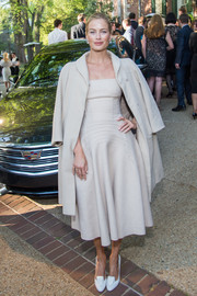 Carolyn Murphy attended the Atlantic private dinner wearing a nude coat over a matching strapless dress.