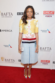 Naomie Harris looked absolutely charming in a color-block floral midi dress by Thom Browne at the BAFTA tea party.