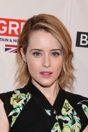 Claire Foy wore her hair short with messy-chic waves at the BAFTA tea party.