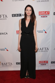 Caitiona Balfe went for minimalist sophistication in a sleeveless black V-neck gown by Ferragamo and Yossi Harari jewelry at the BAFTA tea party.